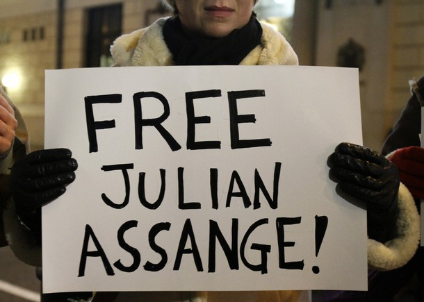 Protester holds banner in support of WikiLeaks founder Assange during a demonstration in front of the British Embassy in Budapest