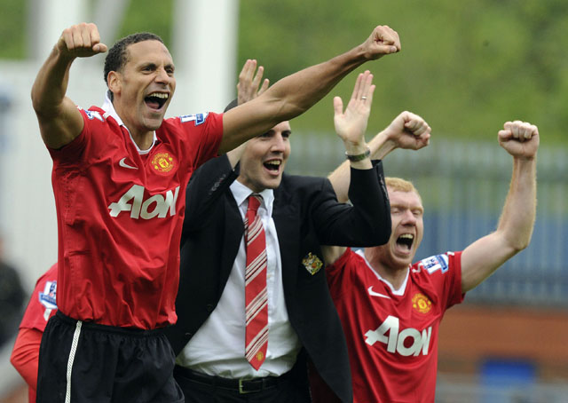 Manchester United's Ferdinand, O'Shea and Scholes celebrate after their English Premier League soccer match in Blackburn
